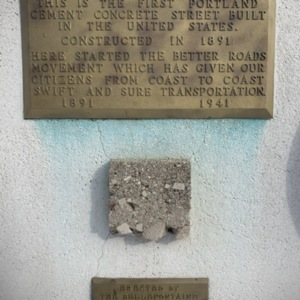 Close Up of Street Fragment and Plaques