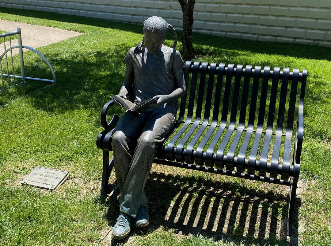 Girl reading on bench.jpeg