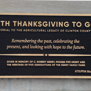 With Thanksgiving plaque.jpeg